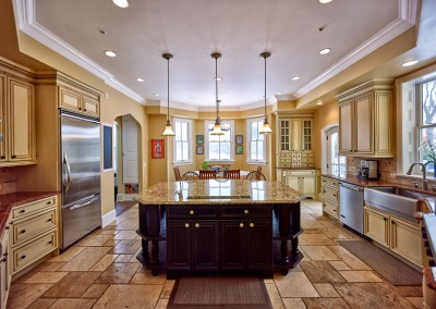 A stunning kitchen remodel featuring custom cabinetry, flooring, and more