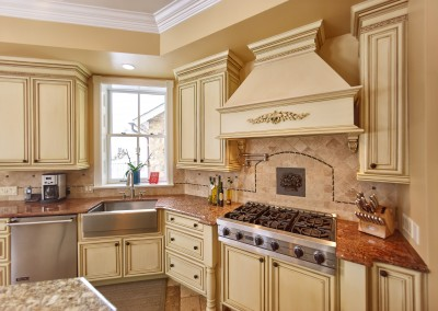 The elegant kitchen coordinates with the rest of the house