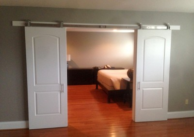 Custom sliding bedroom doors - open - how unique! Engineered by Ricco Builders
