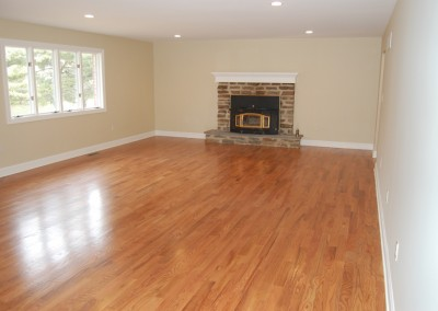 Remodeling for a clean slate: fresh floors, walls, paint, and a restored and renovated fireplace by Ricco Building Group
