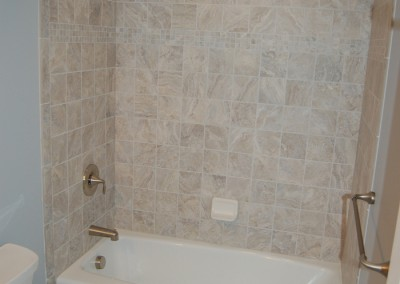 New tile work, fixtures, and tub