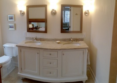 Wainscoting bathroom renovation with cabinetry and vanity
