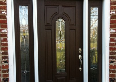 Gorgeous custom front door millwork and installation by Ricco Builders