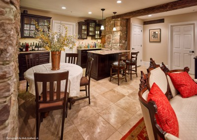 Stunning bar area in a refinished basement by Ricco Builders