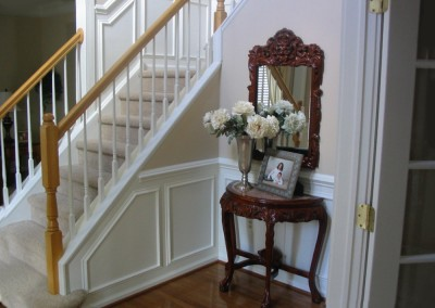 Another coordinating staircase featuring wainscoting for this interior enhancement