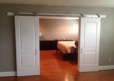 Custom sliding bedroom doors - open - how unique! Engineered by Ricco Builders
