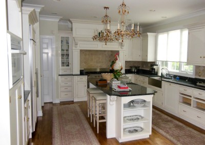 Custom kitchen millwork and cabinetry executed in this renovation