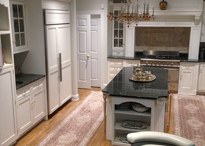 A classic and pretty white kitchen with elegant features custom built to match the home
