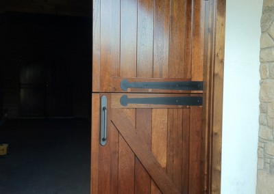 Custom round-top Dutch door for exterior character and function