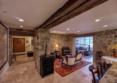 Another view of the refinished basement, matching the stone and woodwork of the rest of the home.